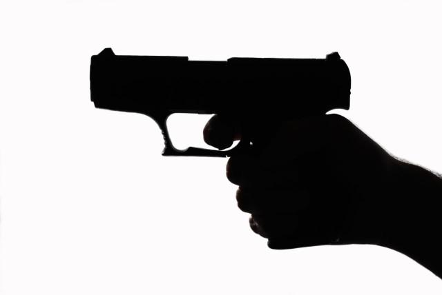 Hand gun in a shadow