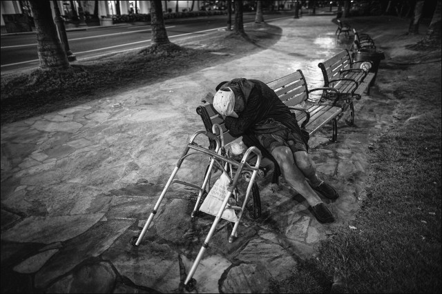 Homeless Waikiki man Kalakaua Ave black & white