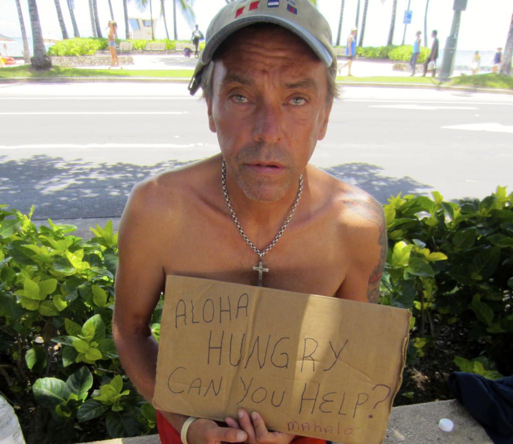 Homeless man panhandles in Waikiki