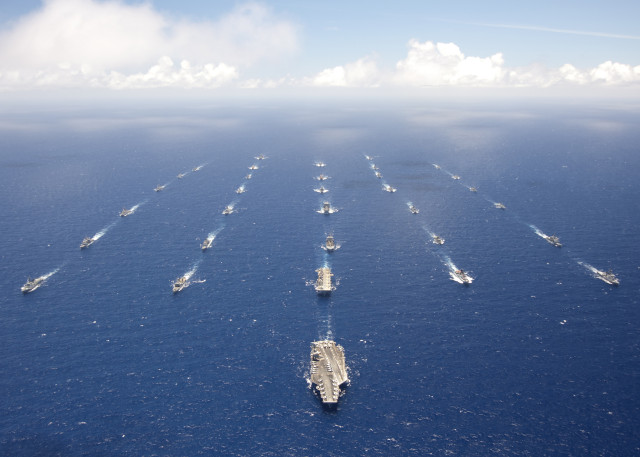 120727-N-VD564-015PACIFIC OCEAN (July 27, 2012)Ships and submarines participating in Rim of the Pacific (RIMPAC) exercise 2012 sail in formation in the waters around the Hawaiian islands. Twenty-two nations, more than 40 ships and submarines, more than 200 aircraft and 25,000 personnel are participating in the biennial Rim of the Pacific (RIMPAC) exercise from June 29 to Aug. 3, in and around the Hawaiian Islands. The world's largest international maritime exercise, RIMPAC provides a unique training opportunity that helps participants foster and sustain the cooperative relationships that are critical to ensuring the safety of sea lanes and security on the world's oceans. RIMPAC 2012 is the 23rd exercise in the series that began in 1971. (U.S. Navy photo by Chief Mass Communication Specialist Keith Devinney/RELEASED)