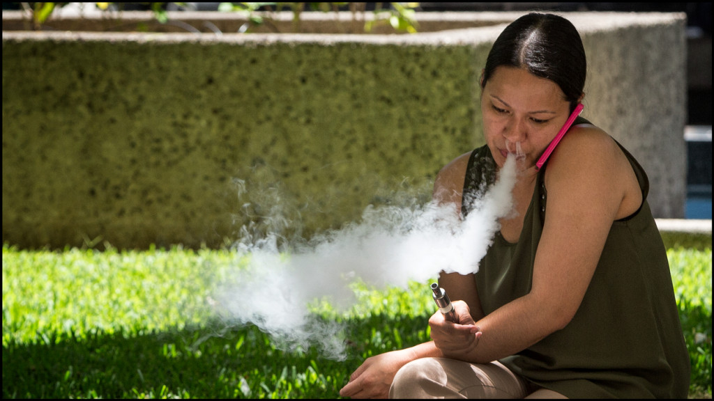 Lead Crop E-Cig smoker exhales in downtown Honolulu on July 9, 2014.