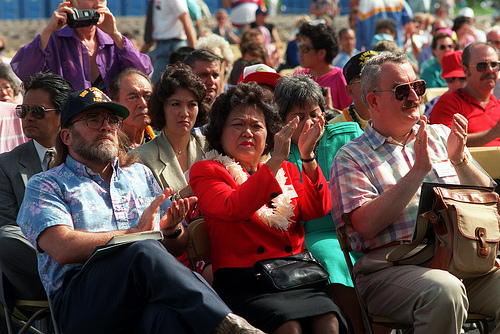 Rep. Patsy Mink and the audience applaud during Remembrance Day ceremonies at the USS ARIZONA Memorial Visitors Center.  USS ARIZONA  survivors are honored during the commemoration of the 50th anniversary of the Dec. 7, 1941, attack on Pearl Harbor.