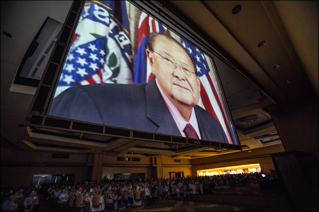 The image of the late Sen. Dan Inouye in a tribute film looms over delegates to open of the second day of the Democratic Party of Hawaii State Convention. 5.25.14©PF Bentley/Civil Beat