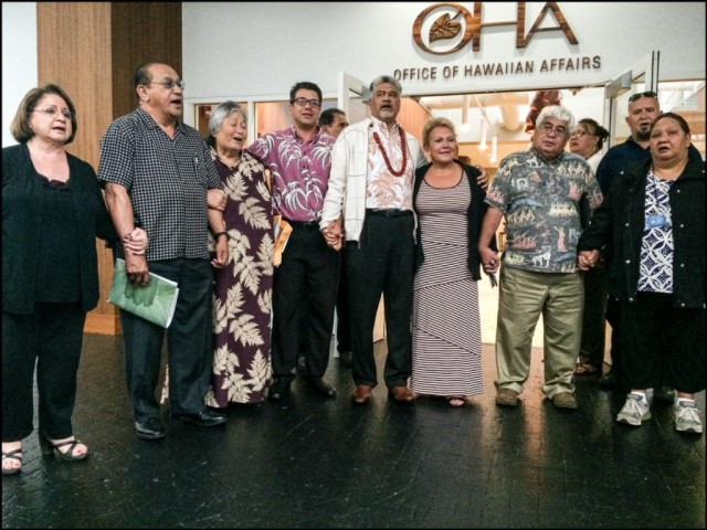 OHA trustees, others holding hands