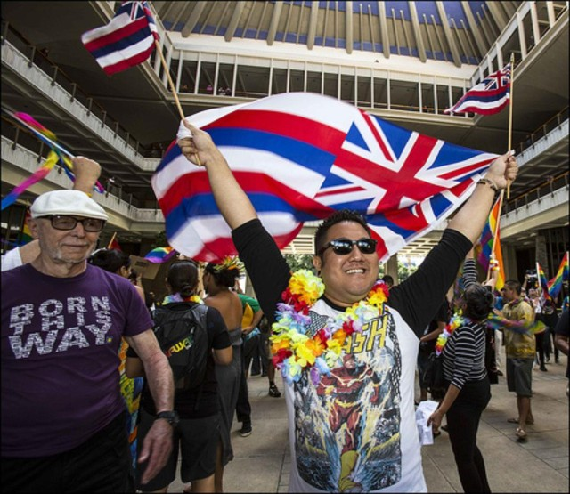 A gay marriage supporter celebrates passage of same-sex marriage legislation at the Hawaii State Capitol.