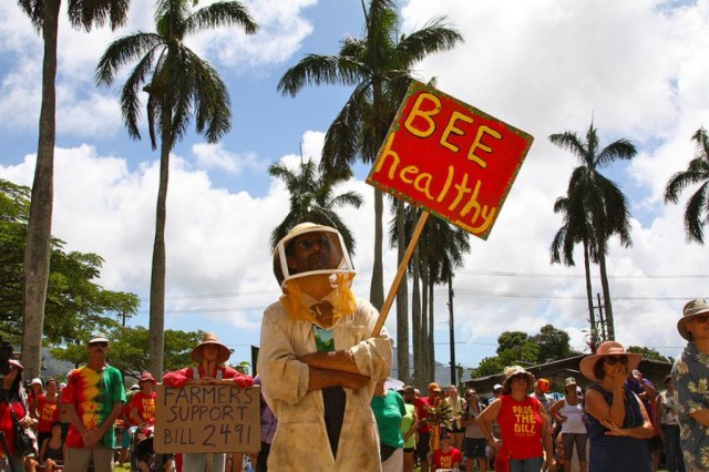Mana March. GMO. bee sign