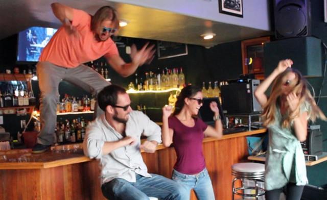 Random people dance in a bar in Honolulu.