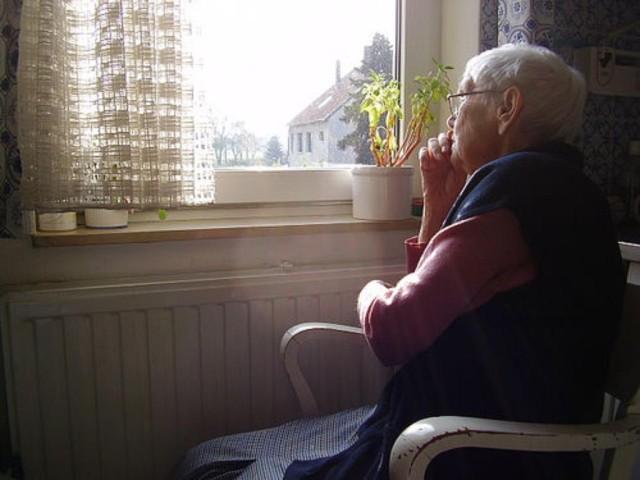 Elderly woman window