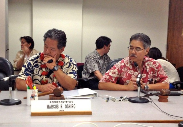 Rep. Marcus Oshiro and then-Sen. David Ige work on the state budget in 2012 when Oshiro was Finance Committee chair.