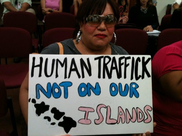 Anti Human Trafficking Advocate holding a sign