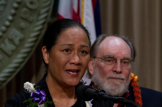 Mina Morita, former PUC chair, speaks during a press conference in 2011 as former Gov. Neil Abercrombie listens.
