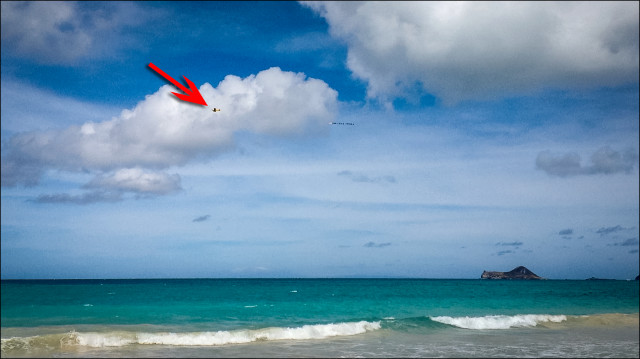 Aerial banner ad flies over Waimanalo Beach.