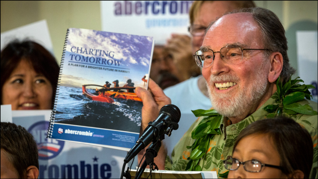 At Abercrombie Campaign Headquarters on July 30, 2014 Gov. Abercrombie holds up his plan for the state should he be elected to another term.