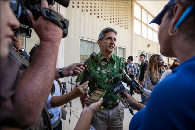 Meet the Press. UH President David Lassner speaks to local media outside Bachman Hall on the UH Manoa campus after speaking with students and faculty about the termination of Manoa Chancellor Tom Apple on July 31, 2014
