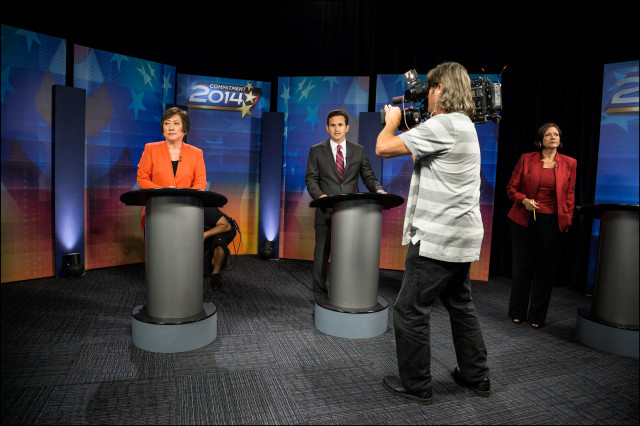 Ready for Their Close-ups. KITV cameraman gets some footage for 10 o'clock news before the start of senatorial debate.
