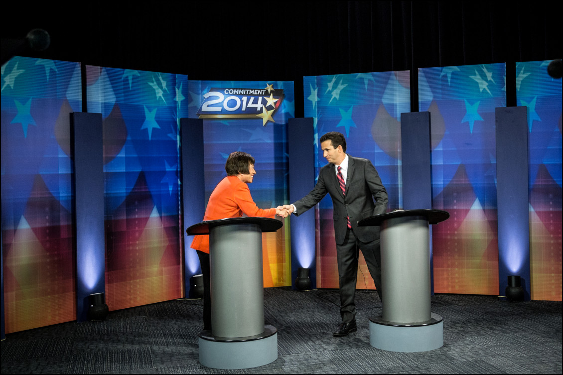 Rep. Colleen Hanabusa and Sen. Brian Schatz shake hands at the end of their televised debate on KITV.