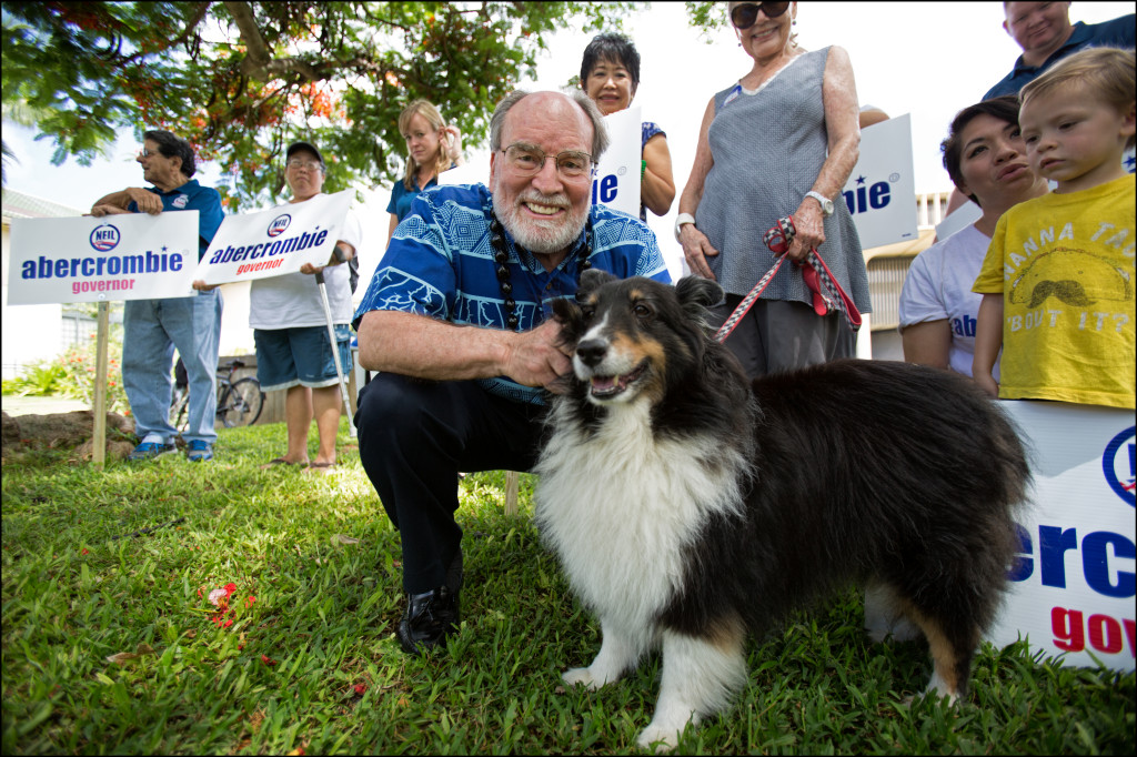 Gov. Neil Abercrombie poses with his dog, Kanoa, before accepting Mayor Kirk Caldwell's endorsement for re-election as governor Monday.