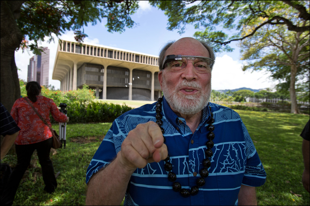 Gov. Neil Abercrombie, wearing Google glasses, makes sure Civil Beat photographer PF Bentley knows he's being Googled at that very moment Monday. Hopefully, the governor found some good information about Bentley's past when he worked for Time Magazine.