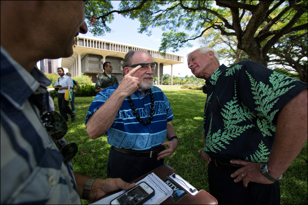 Gov. Neil Abercrombie explains to Mayor Kirk Caldwell how Google glasses work after their news conference Monday.