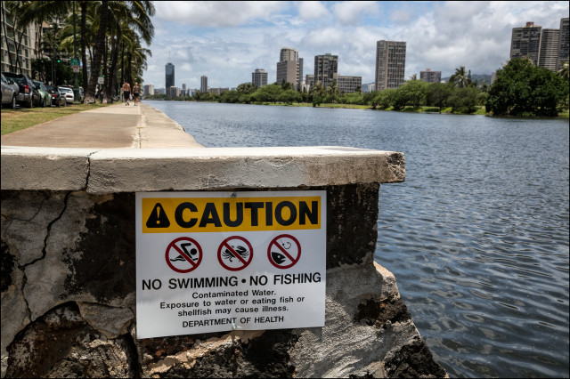 A Department of Health sign warns people that the Ala Wai Canal in Honolulu is contaminated. Surfrider Foundation wants the state to post more warning signs in places known to have unsafe levels of enterococcus bacteria.