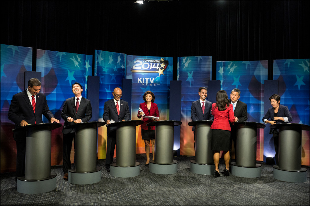 The seven Democratic congressional candidates moments after they went off the air Wednesday night at their last debate of the primary campaign. Moderator and KITV anchor Yunji de Neis is with her back turned, saying goodbye to Mark Takai.