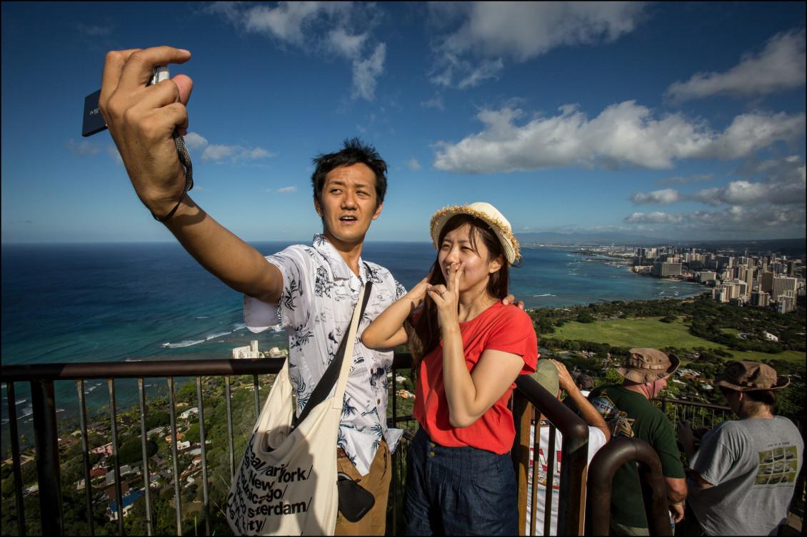 Asian tourists do selfie on top Diamond Head on July 24, 2014