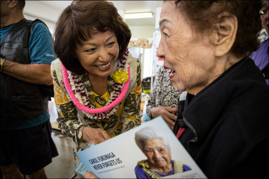Congressional candidate and state Senate President Donna Kim speaks with a voter at the Candidates Fair on Friday.
