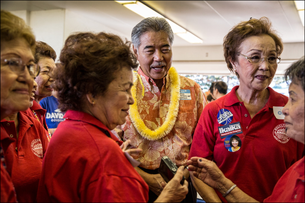 Gubernatorial candidate Sen. David Ige talks with several voters at the Candidates Fair on Friday.