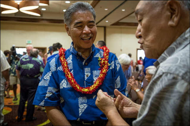Sen. David Ige speaks to senior citizen after debate with Gov. Neil Abercrombie (shown on left of Ige in background) presented by AARP at the King Kamehameha Hotel in Kailua-Kona on July 29, 2014