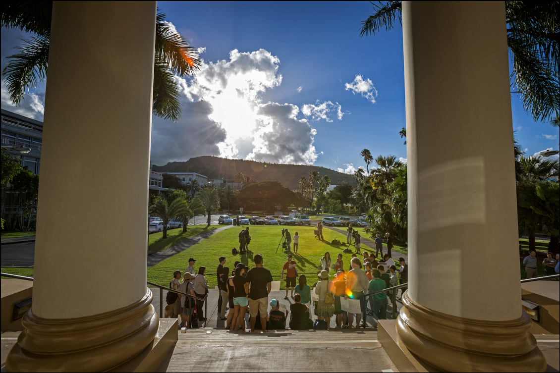 Students and faculty gather outside Hawaii Hall at UH Manoa to march to Bachman Hall to protest the firing of the school's chancellor, Tom Apple, on July 31.