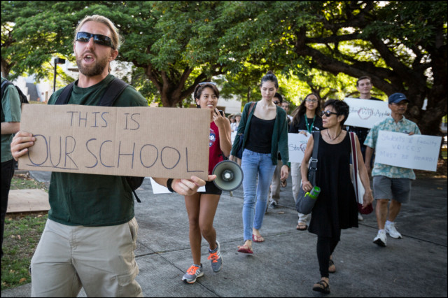 UH Manoa students and faculty march to Bachman Hall on July 31, 2014 to confront UH President David Lassner over the firing of UH Manoa Chancellor Tom Apple.