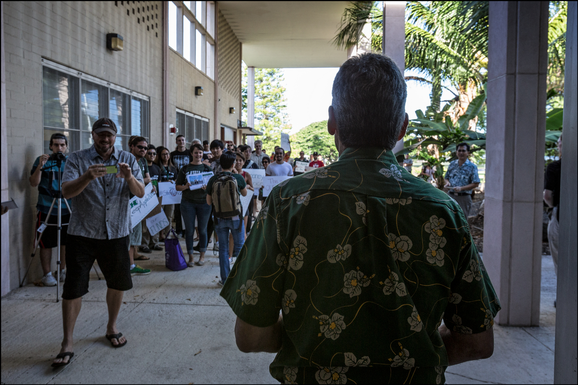 UH President David Lassner, the man who terminated Apple, waits at Bachman Hall to speak with unhappy students and faculty. Lassner gave Apple his termination letter, along with a settlement offer that included a high-paying tenured faculty position and a lump sum payment of $100,000.