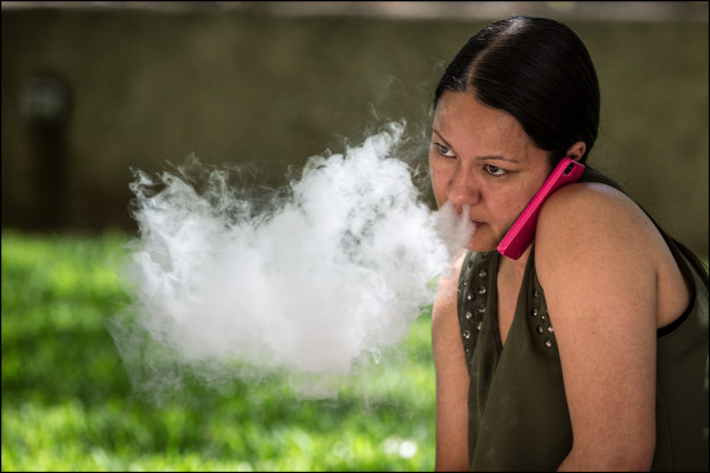 E-Cig smoker exhales in downtown Honolulu on July 9, 2014.