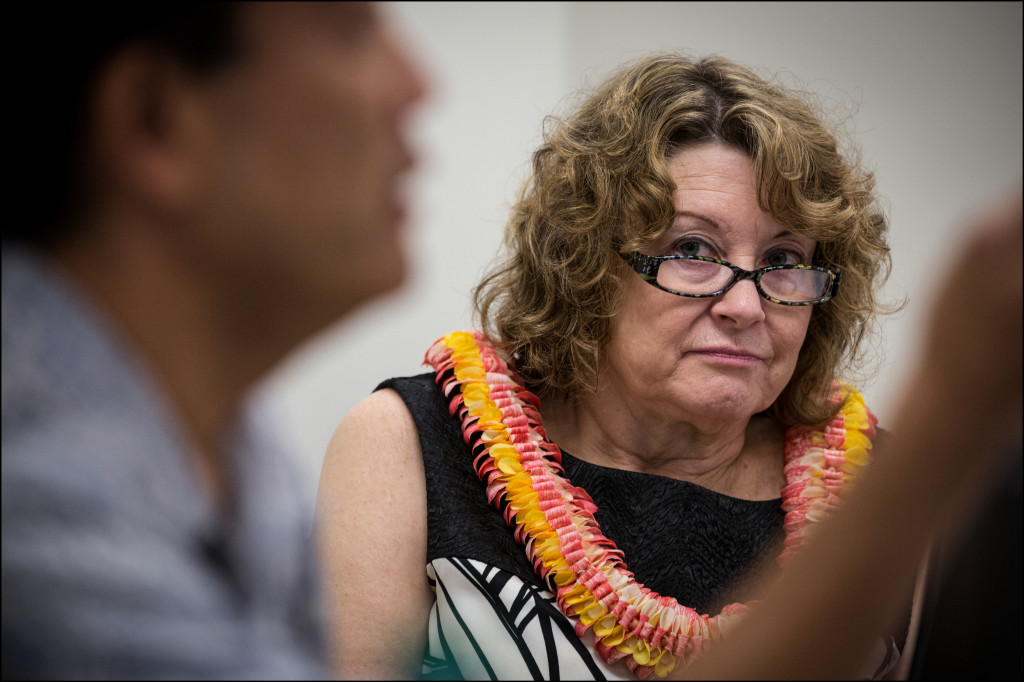 Newly appointed Hawaii State Ethics Commission member Melinda Wood listens to Executive Director Les Kondo at a commission meeting Wednesday.