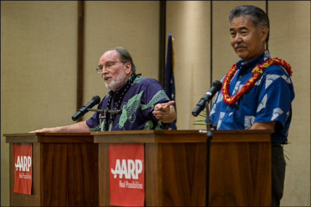 Gov. Neil Abercrombie points to Sen. David Ige during debate presented by AARP at the King Kamehameha Hotel in Kailua-Kona on July 29, 2014