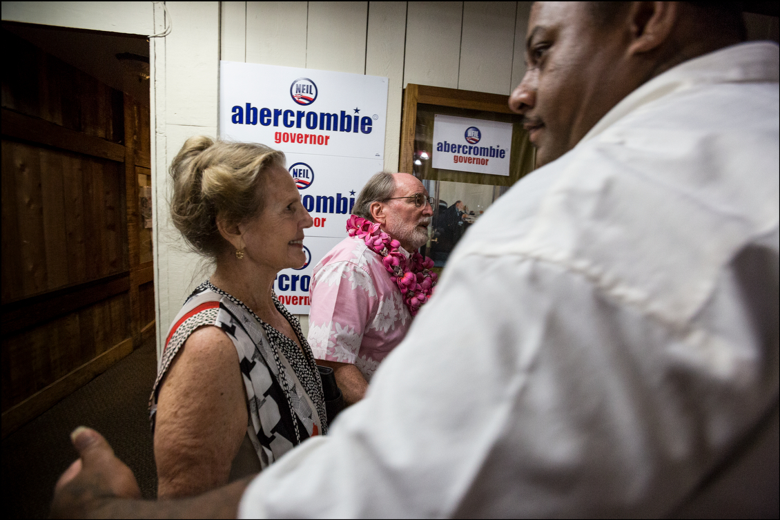 Abercrombie and wife, Nancie Caraway, are ushered into a back room at campaign headquarters before he addressed campaign workers and the public, signaling the beginning of the end of his four decades in Hawaii politics.