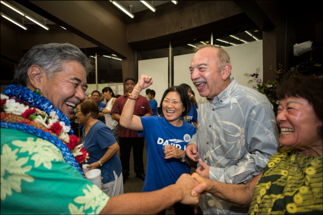 NEW SUPPORTER  Former Hawaii Gov. John Waihee shares a joke with Sen. David Ige and supporters at Ige headquarters on Primary night.