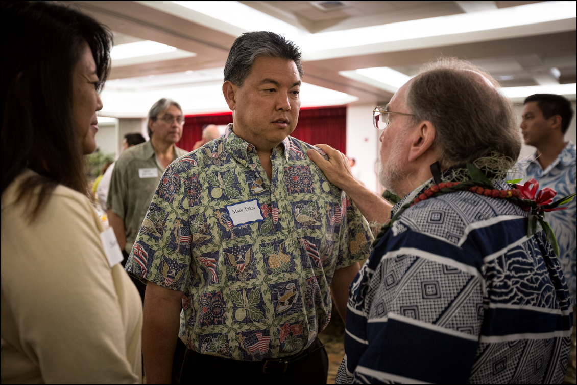 Freshly-elected 1st Congressional District Democratic nominee Mark Takai gets some advice from the governor, who spent 18 years in Congress. The former military man faces a general election race against one of the stronger statewide Republican candidates, Charles Djou, who was the overwhelming winner of his party's primary.