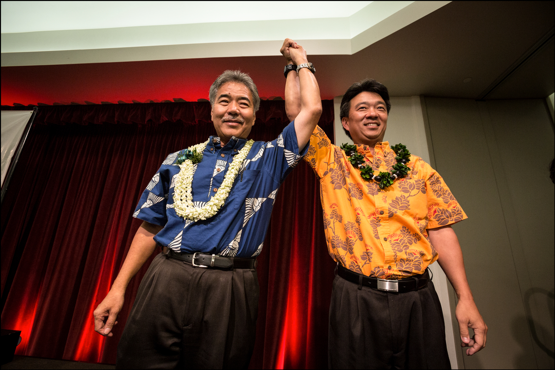 On the sidelines of the breakfast, Ige and Shan Tsutsui, the party's lieutenant governor nominee, attempt to project strength and unity for their party's ticket.