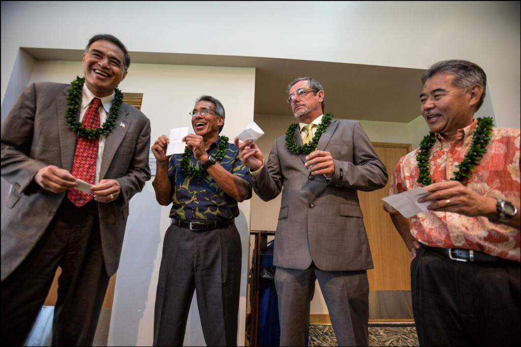 The four gubernatorial candidates draw numbers before the start of forum at UH West Oahu presented by the West Oahu Economic Development Association for the order of opening and closing statements:  Mufi Hannemann, Independent Party, Duke Aiona, Republican Party, Jeff Davis, Libertarian Party, Sen. David Ige, Democratic Party on August 26, 2014