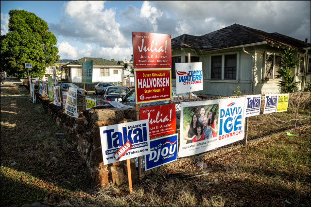 Campaign signs along wall of one house on Waialae Ave in Kaimuki on August 27, 2014