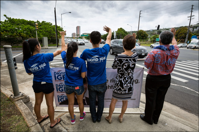 Sen. David Ige and his ohana do some last minute sign waving along Kalanianaole Highway on Primary Day August 9, 2014.