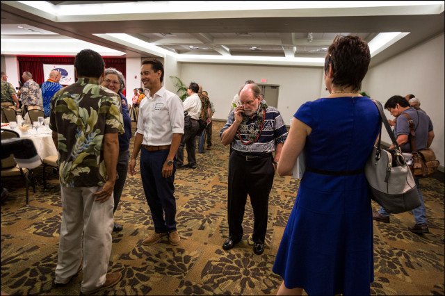Gov. Neil Abercrombie attends to business at the start of the Democratic Party Unity Breakfast on August 10, 2014