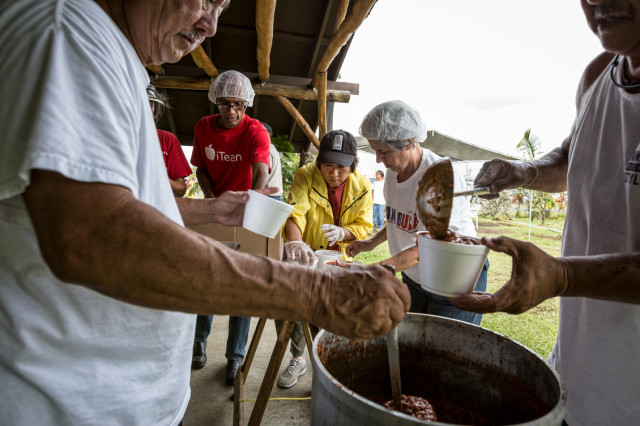 Rep. Colleen Hanabusa is just another worker helping package up chili at the Makuu Farmers Market near Pahoa in Puna on August 12, 2014