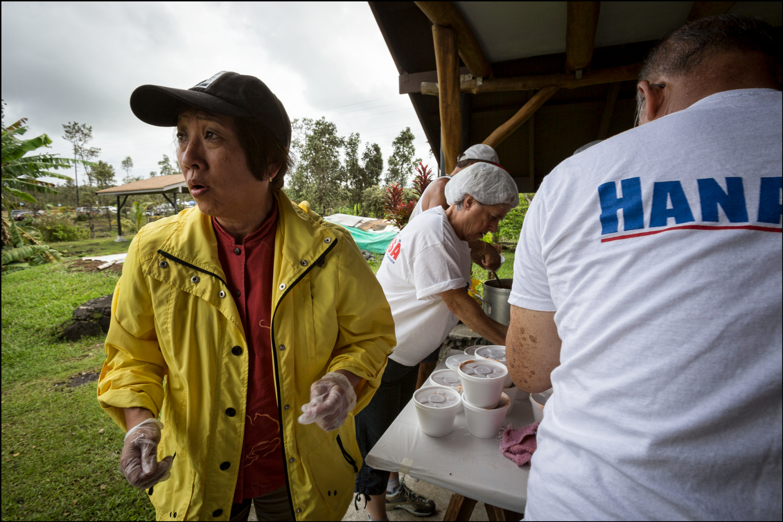 Hanabusa checks on cars lining up to pick up food to deliver it to the needy. While Hanabusa supporters campaigned openly amid their charitable efforts, the official Schatz campaign was quiet until Election Day, when it too waved signs.