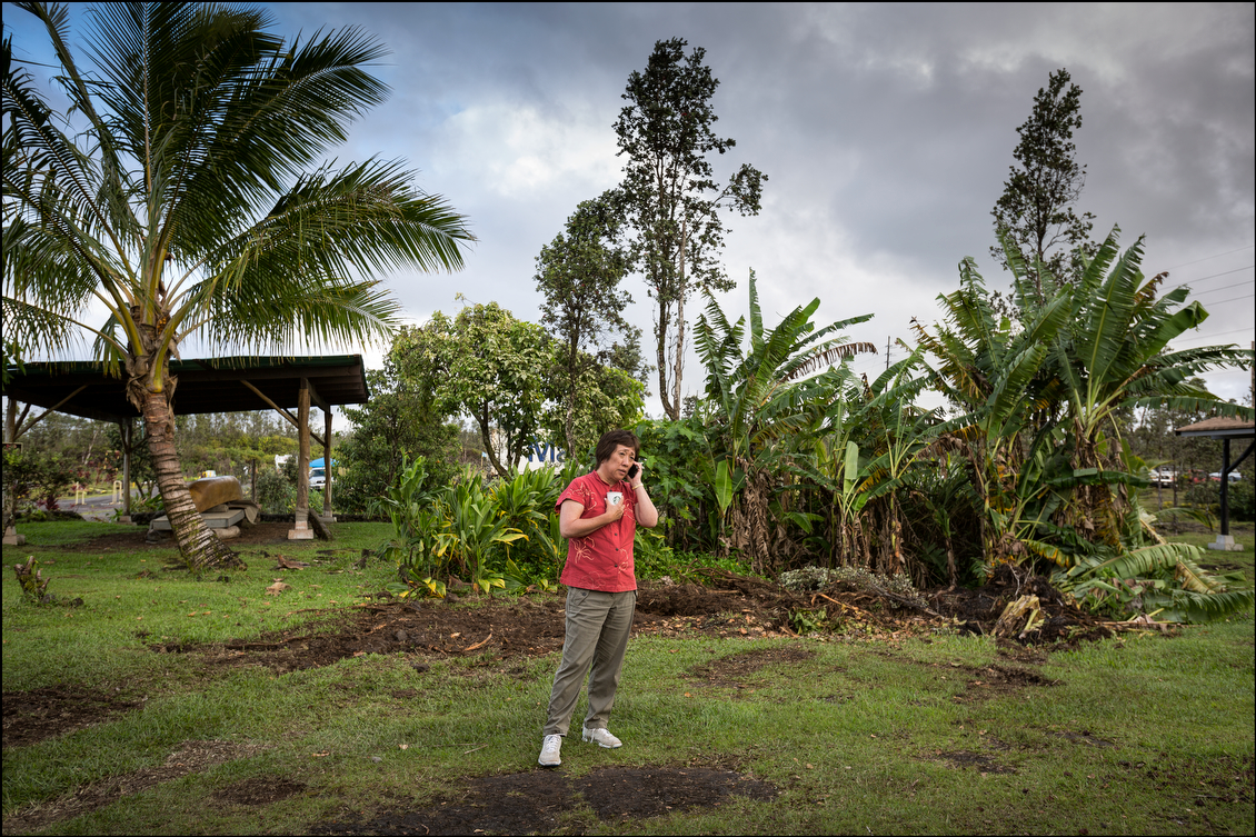 Hanabusa, whose U.S. congressional district does not include Puna, worked the phone during a break from food distribution.