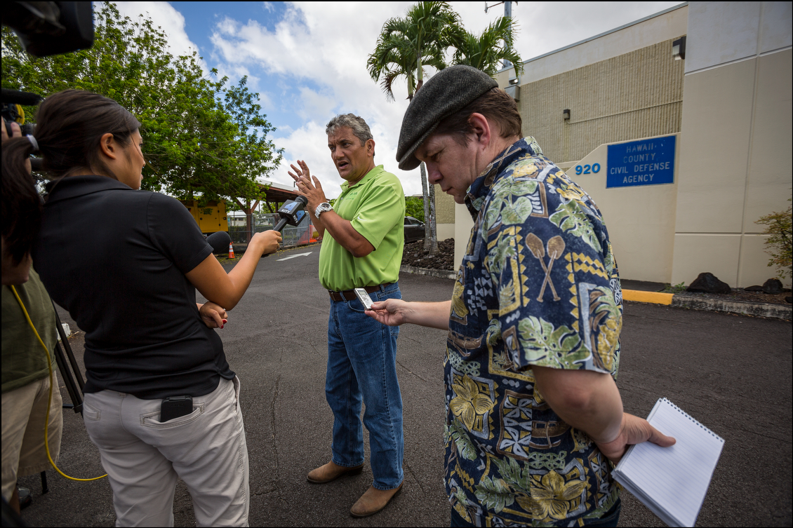 Hawaii County Mayor Billy Kenoi speaks to media outside the county's Civil Defense building in Hilo 0n Aug. 13. Kenoi said crews were doing all they good to make sure roads were cleared for Election Day.
