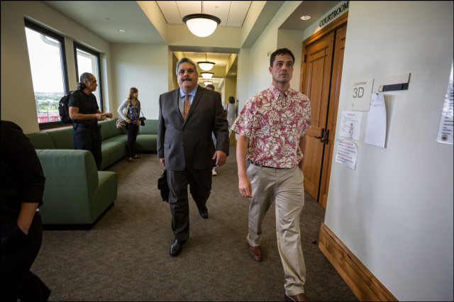 Attorney for Hanabusa Richard Wurdeman and Hanabusa campaign spokesperson Peter Boylan leave courtroom after Circuit Court Judge Greg Nakamura ruled to hold the election as scheduled.  August 14, 2014