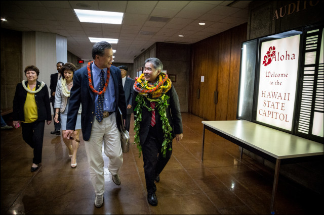 Senators David Ige and Clayton Hee lead fellow senators across the hall to the House Chamber for the singing of Hawaii Ponoi with House members on the last day of the Legislative session for 2014. May, 1, 2014