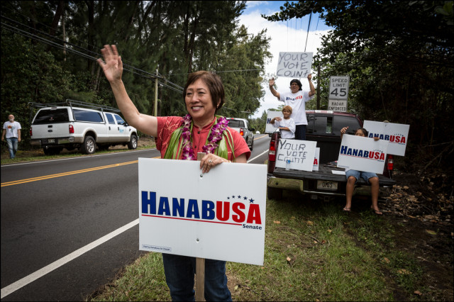 Rep. Colleen Hanabusa waves to voters in the Puna District on special election day August 15, 2014.